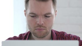 Young Man Working On Laptop, Front Close Up stock footage