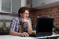 Young man working on laptop. Royalty Free Stock Photography