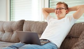 Young man working with laptop at home royalty free stock photos