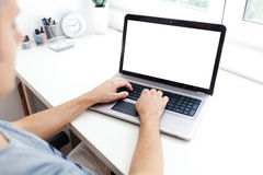 Young man working on laptop Royalty Free Stock Photo