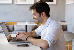 Young man working on laptop indoors Royalty Free Stock Photography