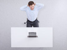 Young man  working on laptop, sitting  the desk in Royalty Free Stock Photos