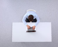 Young man working on laptop, sitting the desk in Royalty Free Stock Photography