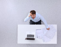 Young man working on laptop, sitting the desk in Stock Photography