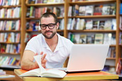 Young man working in a library Stock Photo