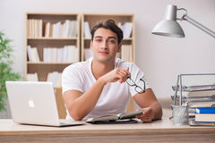 The young man working in the office Royalty Free Stock Image