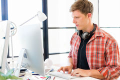 Young man working in office Royalty Free Stock Images