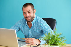 Young man working in office Stock Photos