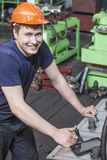 The young man working at the old factory on installation of equi Royalty Free Stock Photos