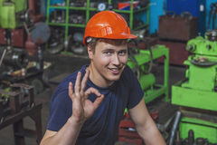 The young man working at the old factory on installation of equi Stock Photos