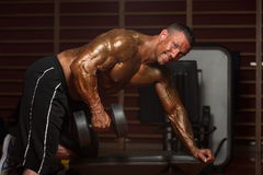 Young Man Working Out Back With Dumbbell Stock Images