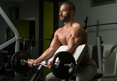 Young Man Working Out Biceps Stock Images