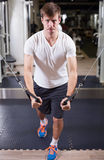 Young man working out in gym pecs exercise Royalty Free Stock Image