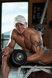 Young Man Working Out In A Health Club Stock Image