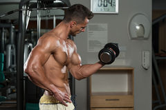 Young Man Working Out In A Health Club Stock Photo