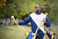 Young man working out at outdoor gym Royalty Free Stock Images