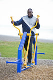 Young man working out at outdoor gym Royalty Free Stock Photo