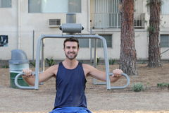 Young man working out at the park.  Stock Image