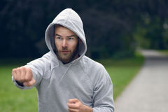 Young man working out in a park punching air Royalty Free Stock Photos