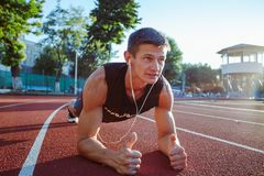 Young Man Working Out On Running Track stock image