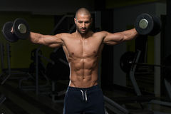 Young Man Working Out Shoulders Royalty Free Stock Photo