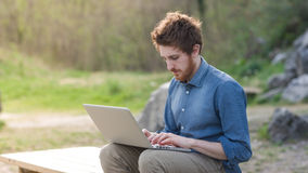Young man working outdoors Stock Photography