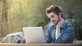 Young man working outdoors Royalty Free Stock Photos