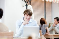 Young man is working on the pc royalty free stock image