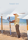 Young man working remotely under the umbrella Royalty Free Stock Photos