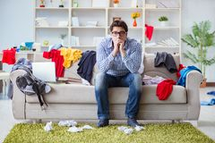 The young man working studying in messy room stock image