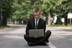Young Man Working On Tablet Outside The Office Royalty Free Stock Photo