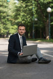 Young Man Working On Tablet Outside The Office Stock Photo