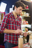 Young man working in teahouse Royalty Free Stock Image