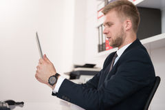 Young Man Working On Touchpad In Office Royalty Free Stock Photos