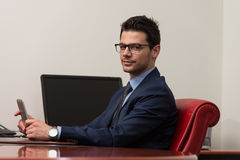 Young Man Working On Touchpad In Office Royalty Free Stock Images