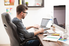 Young man working with two computers Royalty Free Stock Photo