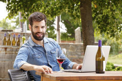 Young man working in a vineyard Royalty Free Stock Image