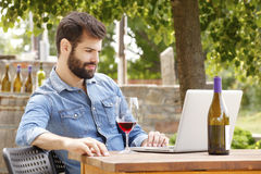 Young man working in a vineyard Stock Images