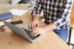 Free Young Man Working With Laptop At Desk Royalty Free Stock Photography - 115274447