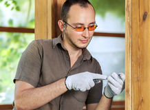 Young man working with wood Royalty Free Stock Photos