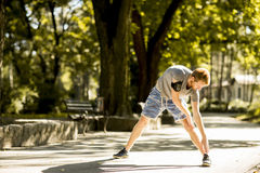 Young man workout in the autumn park Royalty Free Stock Photography