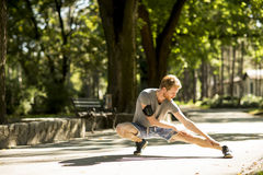 Young man workout in the autumn park Stock Photos