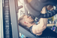 Young man workout in gym. Man lift weight in gym Royalty Free Stock Photos