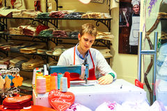 Young man works in the gift shop, Verona, Italy Royalty Free Stock Photography