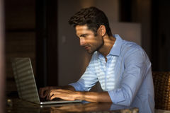 Young man he works on his laptop Royalty Free Stock Photography
