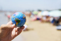 Young man with a world globe in his hand stock photos