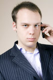 Young man worried on a cellphone Stock Photography