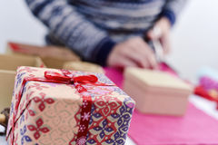 Young man wrapping a gift Royalty Free Stock Image