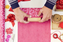 Young man wrapping a gift Stock Image