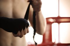 Young man wrapping hand with bandage. In boxing ring Royalty Free Stock Images